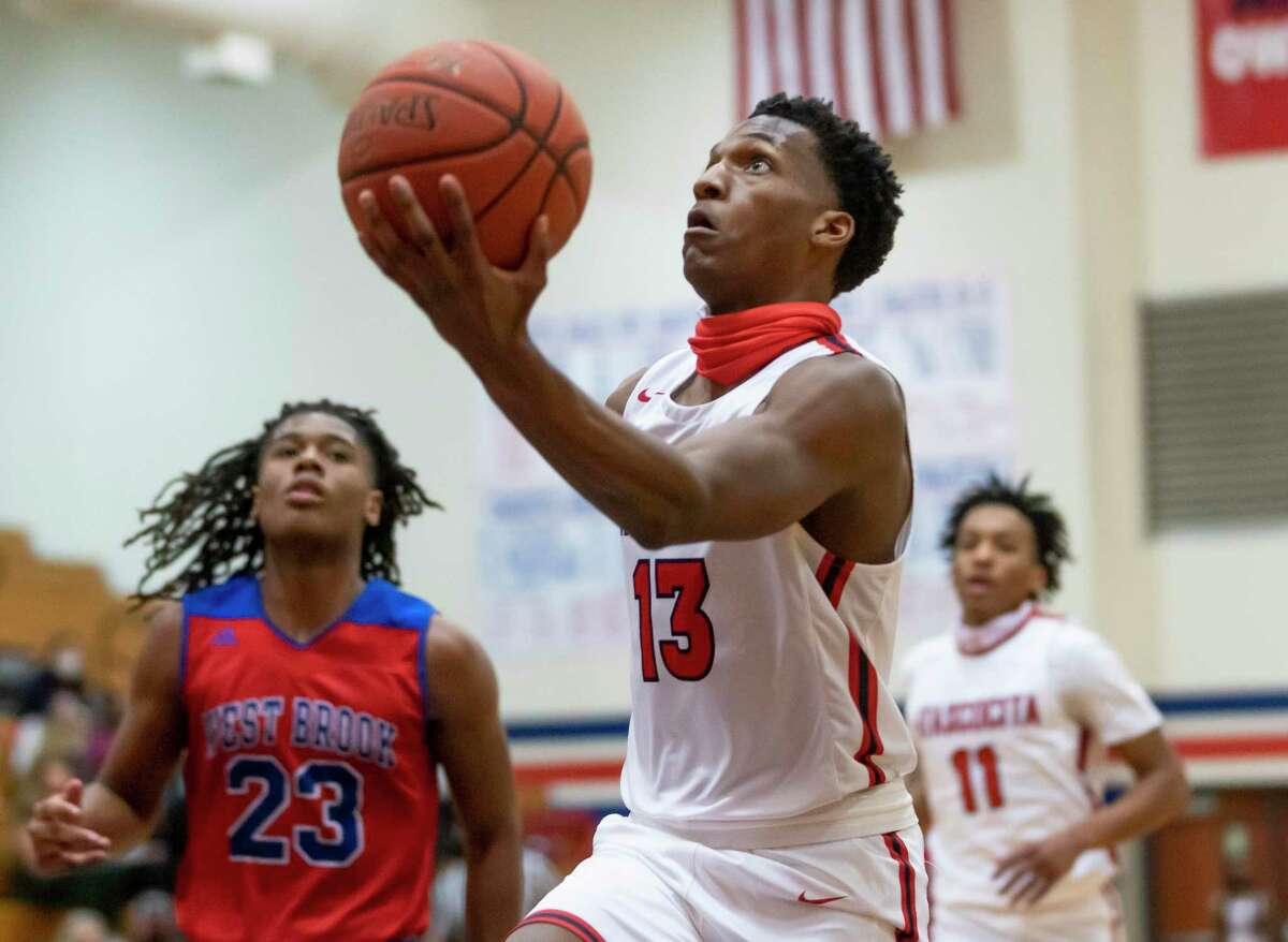Atascocita point guard Justin Collins (13) jumps toward the basket during the first quarter of a District 21-6A basketball game against Westbrook at Atascocita High School, Wednesday, Jan. 13, 2021, in Humble.