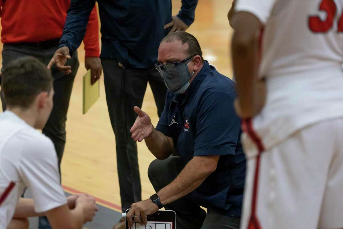 Atascocita head coach David Martinez speaks with his team during a timeout session during the fourth quarter of a District 21-6A basketball game at Atascocita High School, Wednesday, Jan. 13, 2021, in Humble.