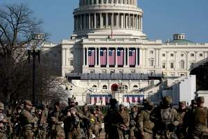 Members of the National Guard stood outside the U.S. Capitol on Thursday. About 00 members of the Connecticut National Guard have been dispatched there in preparation for the Jan. 20 inauguration of President-elect Joe Biden. Similar security measures are underway at the State Capitol in Hartford, and other sites in the state.