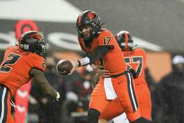 Oregon State quarterback Ben Gulbranson (17) hands off to running back Calvin Tyler, Jr. (2) during an NCAA college football game against Arizona State in Corvallis, Ore., Saturday, Dec. 19, 2020. Arizona State won 46-33. (AP Photo/Amanda Loman)