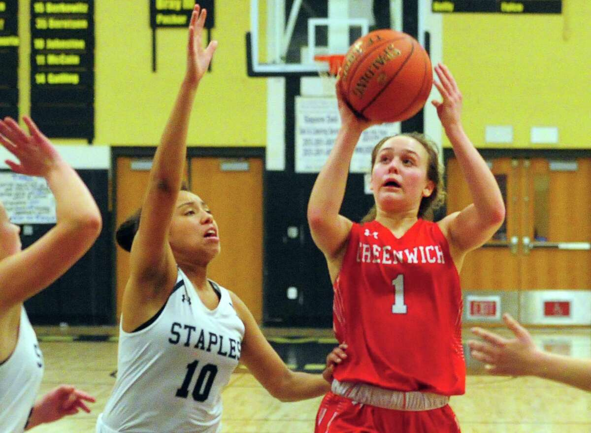 Greenwich's Ava Sollenne (1) ooks to score as Staples' Nicole Holmes (10) defends during FCIAC Girls' Basketball Quarterfinals action against Staples in Trumbull, Conn., on Tuesday Feb. 25, 2020.