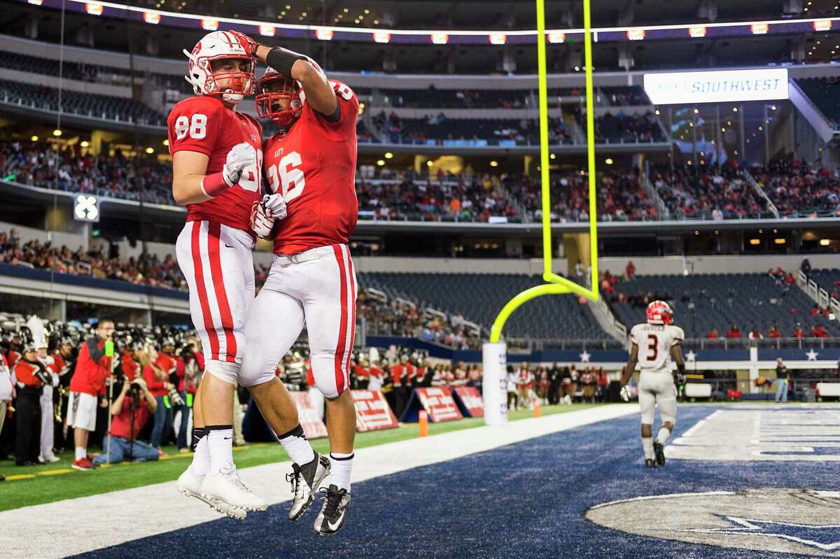 In 2013, Katy had an early lead over Cedar Hill as Sloan Spiller celebrates a 44-yard TD reception with Rodney Anderson.