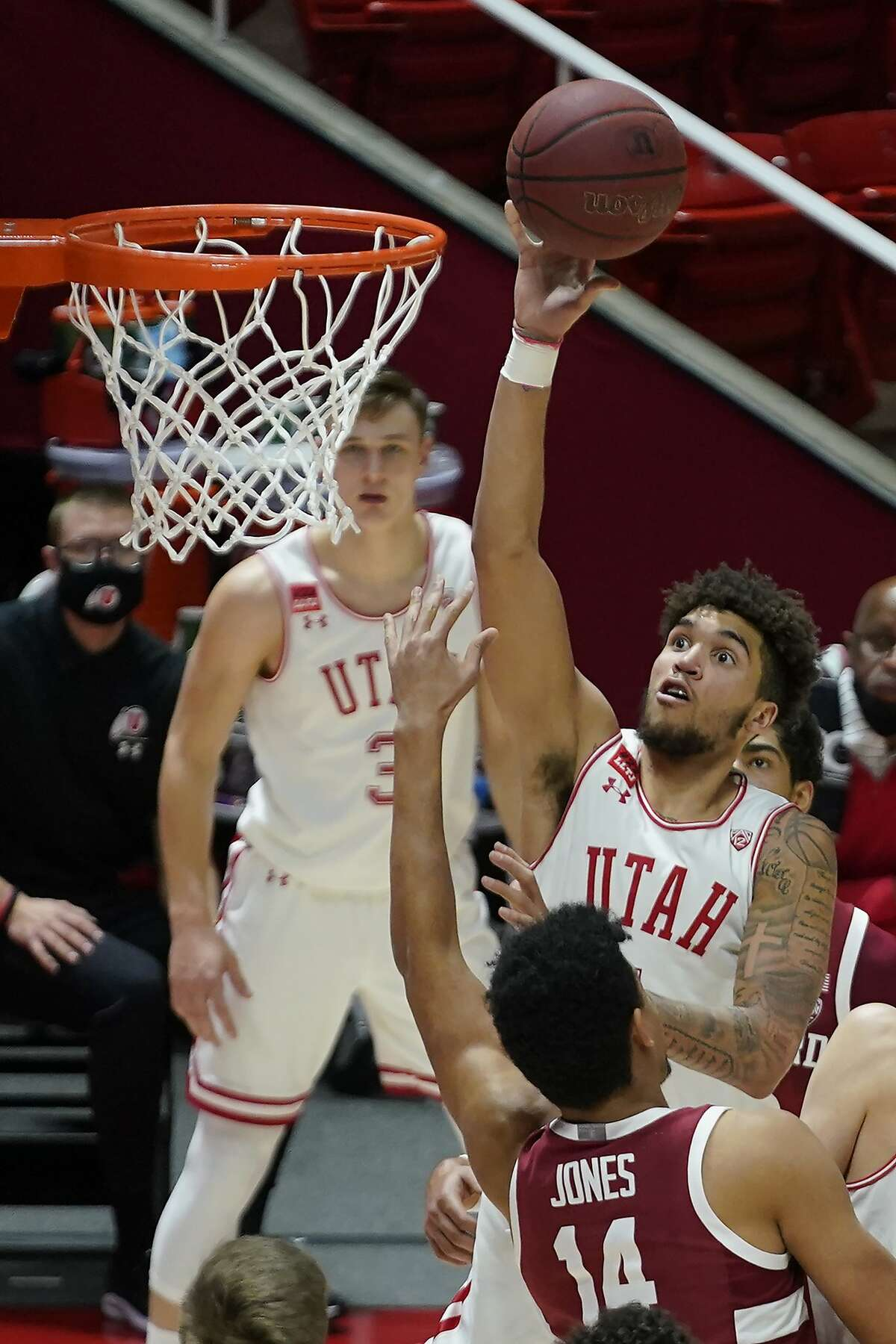 Utah forward Timmy Allen (1) shoots as Stanford forward Spencer Jones (14) defends in the second half during an NCAA college basketball game Thursday, Jan. 14, 2021, in Salt Lake City. (AP Photo/Rick Bowmer)