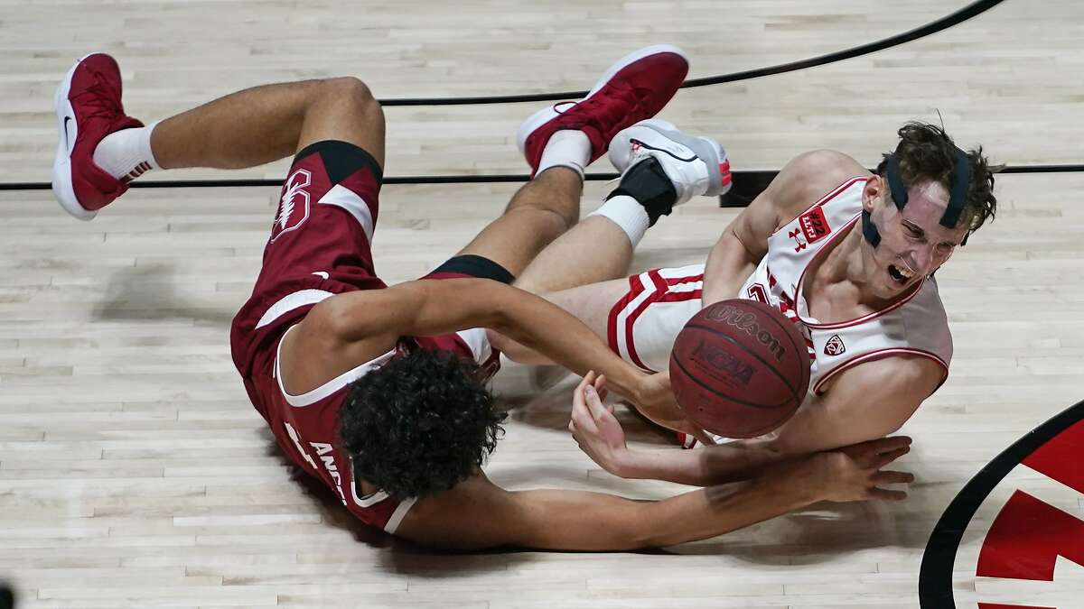 Stanford forward Brandon Angel, left, and Utah forward Mikael Jantunen, right, battle for a loose ball in the second half during an NCAA college basketball game Thursday, Jan. 14, 2021, in Salt Lake City. (AP Photo/Rick Bowmer)