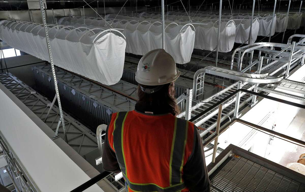 David Yeager, project manager for Vistra Zero, looks over the battery array in the old generator building at the Moss Landing Power Plant on Wednesday.