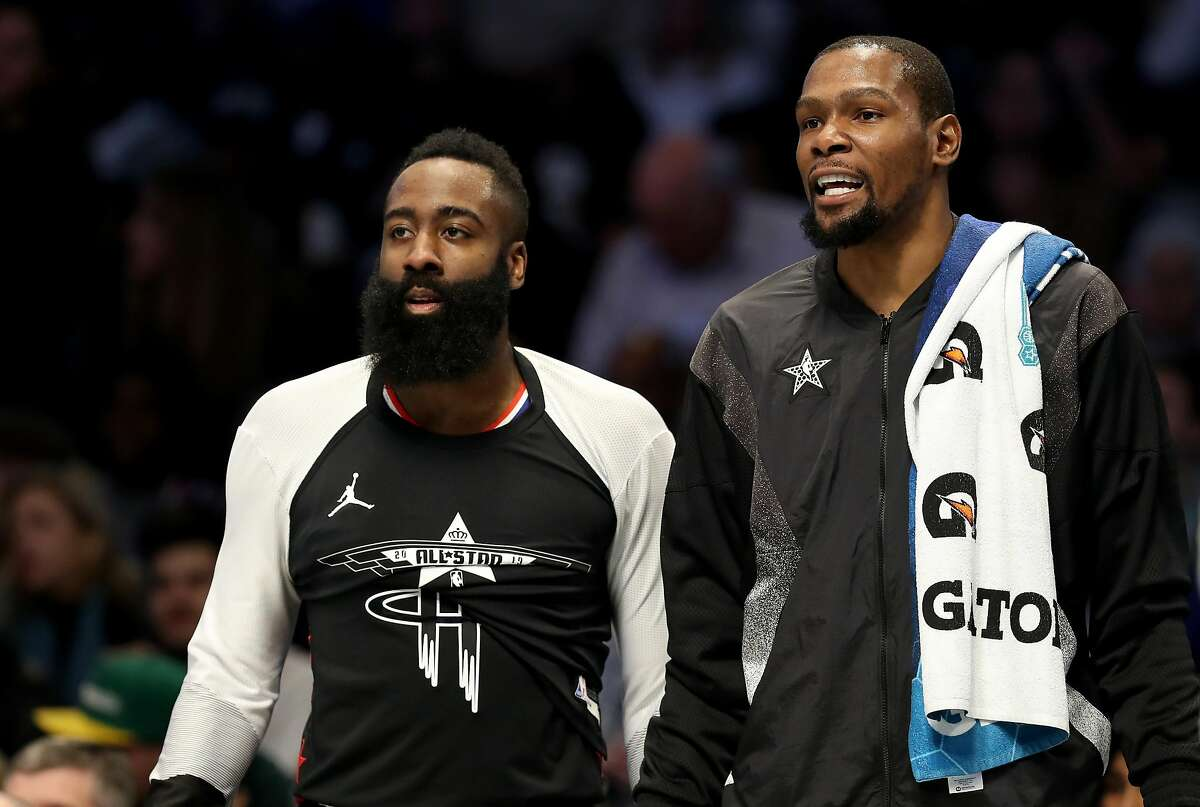 FILE - January 13: According to reports, the Houston Rockets have traded James Harden to the Brooklyn Nets. CHARLOTTE, NORTH CAROLINA - FEBRUARY 17: James Harden #13 of the Houston Rockets and teammate Kevin Durant #35 of the Golden State Warriors and Team LeBron watch on from the bench during the NBA All-Star game as part of the 2019 NBA All-Star Weekend at Spectrum Center on February 17, 2019 in Charlotte, North Carolina. NOTE TO USER: User expressly acknowledges and agrees that, by downloading and/or using this photograph, user is consenting to the terms and conditions of the Getty Images License Agreement. (Photo by Streeter Lecka/Getty Images)