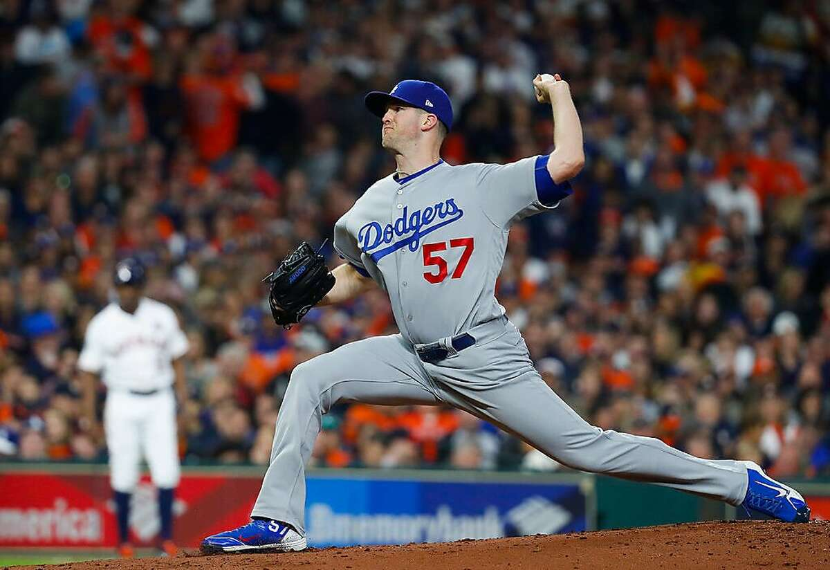 Los Angeles Dodgers starting pitcher Alex Wood (57) pitches during the first inning of Game 4 of the World Series at Minute Maid Park on Saturday, Oct. 28, 2017, in Houston. ( Karen Warren / Houston Chronicle )