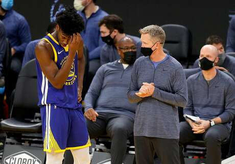 SAN FRANCISCO, CALIFORNIA - JANUARY 12:  Head coach Steve Kerr speaks to James Wiseman #33 of the Golden State Warriors after he picked up his fourth foul in their game against the Indiana Pacers in the second period at Chase Center on January 12, 2021 in San Francisco, California. NOTE TO USER: User expressly acknowledges and agrees that, by downloading and or using this photograph, User is consenting to the terms and conditions of the Getty Images License Agreement.  (Photo by Ezra Shaw/Getty Images)
