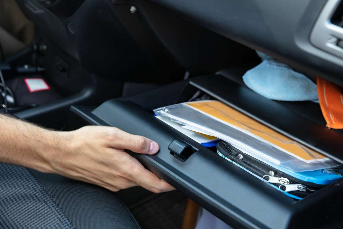 Driver Hand Opening Glovebox Compartment Inside Car
