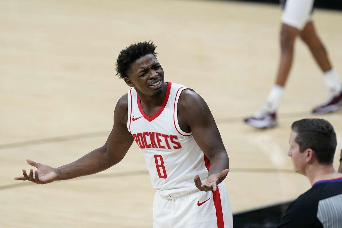 Houston Rockets forward Jae'Sean Tate (8) argues a call during the first half of an NBA basketball game against the San Antonio Spurs in San Antonio, Thursday, Jan. 14, 2021. (AP Photo/Eric Gay)