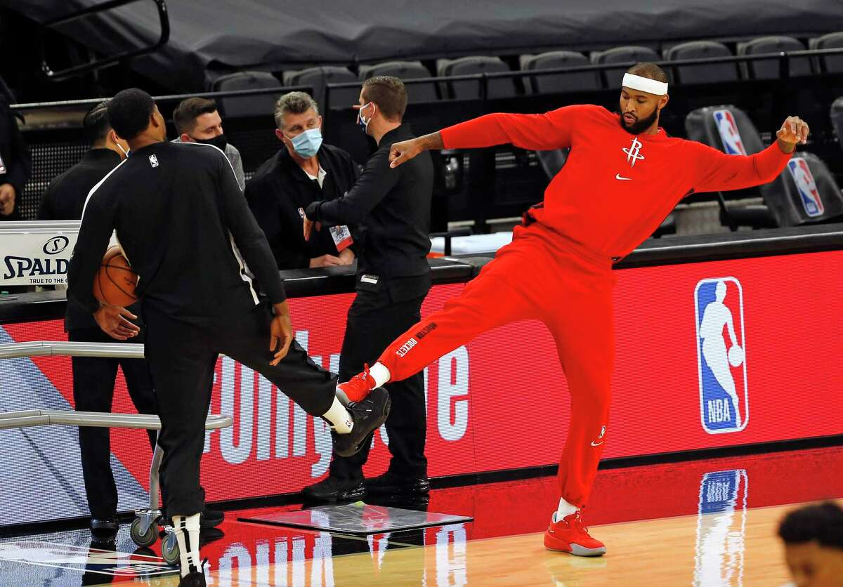 Rudy Gay, left, greets Rockets center DeMarcus Cousins before Thursday's game. Since rupturing his Achilles tendon in 2017, Gay has counseled Cousins and others who've suffered the same injury.