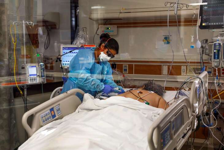 Respiratory Therapist Laura Sandoval prepares to prone a COVID-19 patient in the ICU at Regional Medical Center of San Jose, an acute-care hospital, on Tuesday, Dec. 8, 2020 in San Jose, California. Following Thanksgiving there has been an uptick in COVID-19 cases all over California and the Bay Area.