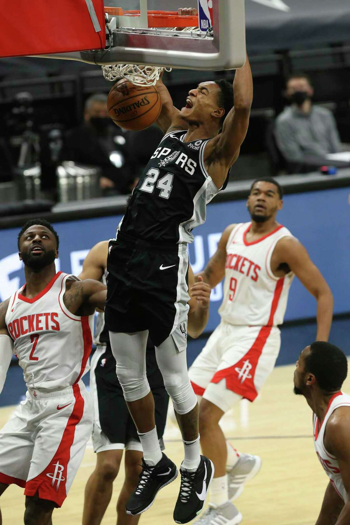 San Antonio Spurs' Devin Vassell slams a two against the Houston Rockets during the first quarter at the AT&T Center, Thursday, Jan. 14, 2021.