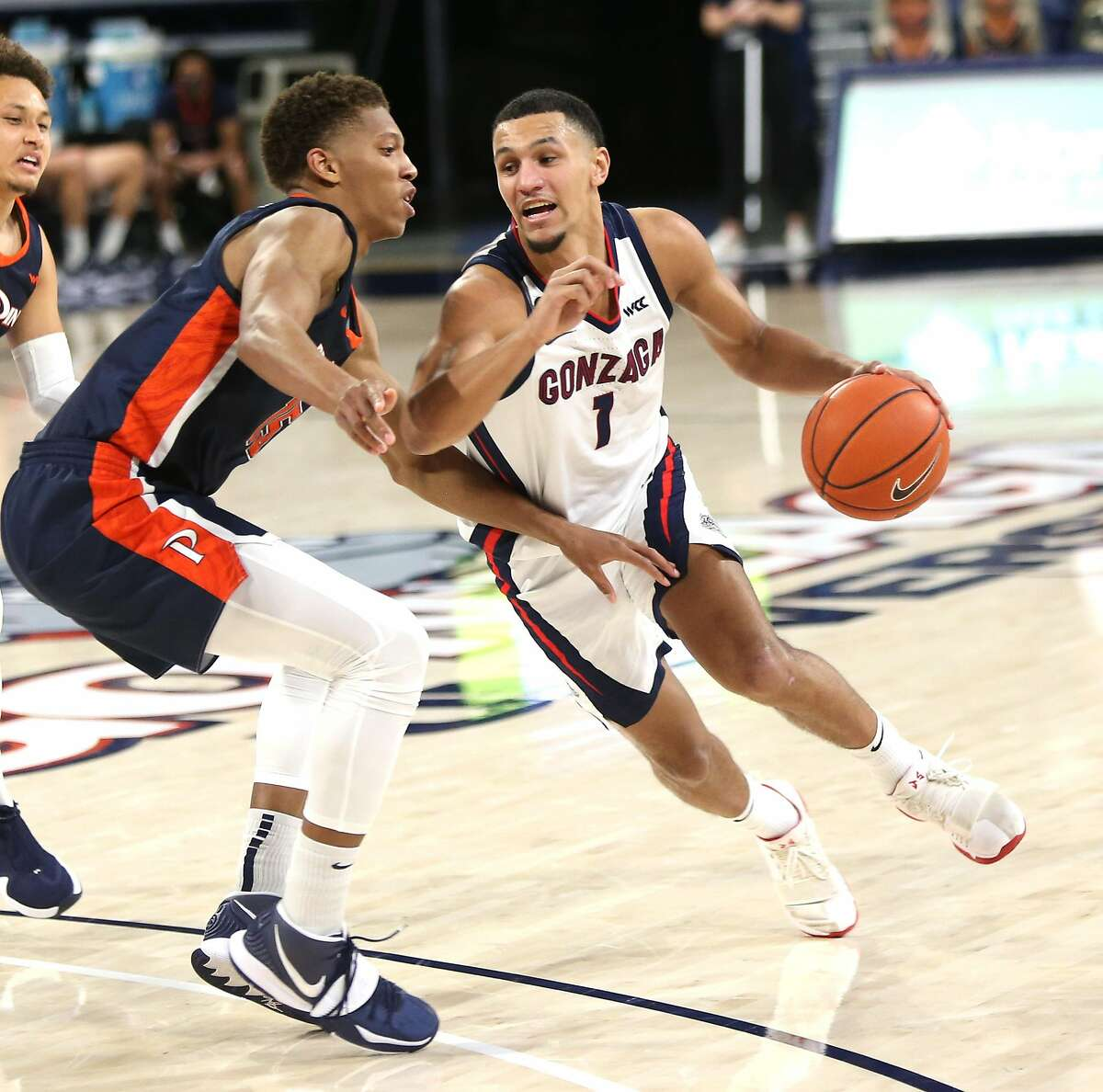 SPOKANE, WASHINGTON - JANUARY 14: Jalen Suggs #1 of the Gonzaga Bulldogs drives against Kessler Edwards #15 of the Pepperdine Waves in the second half at McCarthey Athletic Center on January 14, 2021 in Spokane, Washington. Gonzaga defeats Pepperdine 95-70. (Photo by William Mancebo/Getty Images)