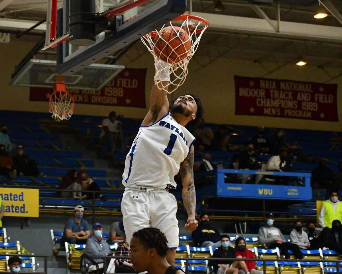 Wayland Baptist's Tre Fillmore throws down a slam dunk in the Pioneers' 78-77 overtime loss to Southwestern Christian in a Sooner Athletic Conference men's basketball game on Thursday in the Hutcherson Center