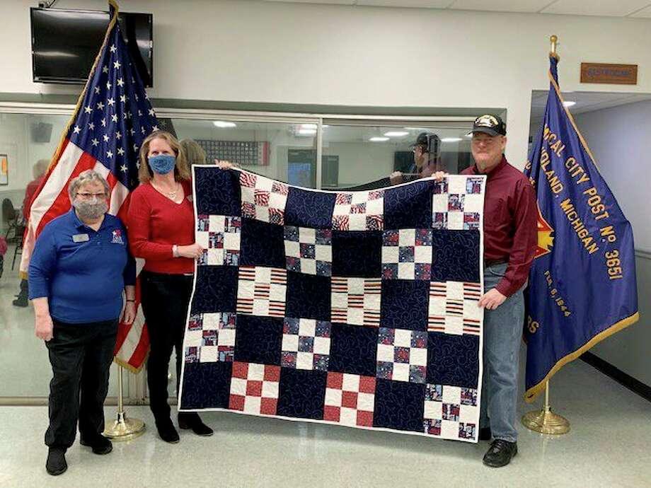 From left, Vice Regent Karen Miller, Chair Nancy Pnacek present Quilt of Valor to veteran Dan Ratell. (Photo provided)