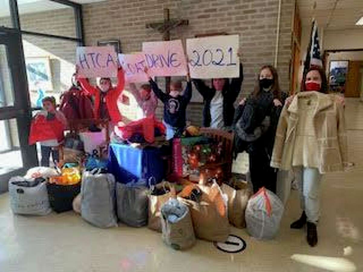 The Holy Trinity Catholic Academy Student Council collected more than 50 coats during its annual coat drive. The coats are being donated to The Umbrella Center for Domestic Violence Services. The coats are going to the distribution center located at the Hope Family Justice Center in New Haven.