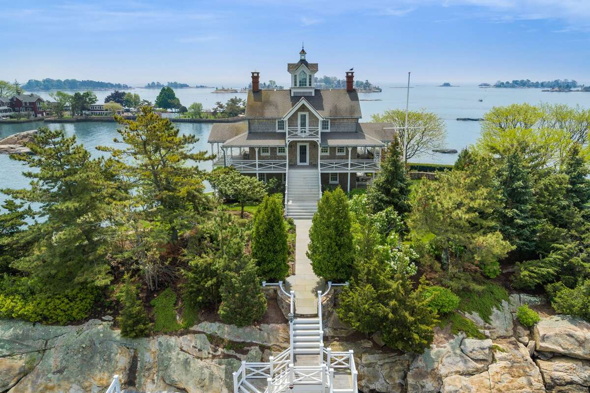 The Victorian house on Wheeler Island, Branford. The hosue also offers a front row seat to fireworks displays over the Long Island Sound in neighboring communities.The Fourth of July also figures prominently inside this turnkey house, which is being sold fully-furnished.  Muir said each of the eight bedrooms has its own theme, including one adorned in red, white and blue. Another has a penguin theme and one is dedicated to frogs. Muir said the owner is a decorative artist who sourced or created much of the unique interior décor.