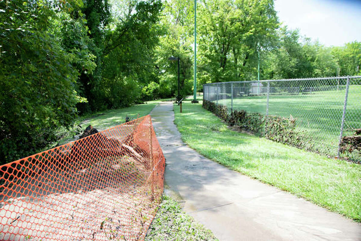 Debris is scattered around the lower portion of Miner Park in Glen Carbon after the creek flooded in August 2020.