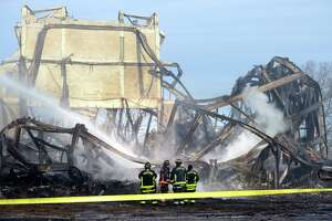In this Sunday, Jan. 13, 2019, photo authorities respond after a fire broke out at the American Shakespeare Theatre in Stratford, Conn. The theatre opened in 1955 and during the 1960s and 1970s, famous actors, including Katharine Hepburn, performed on its stage. The American Shakespeare Festival Theatre held its final full season in the building in 1982. (Ned Gerard/Hearst Connecticut Media via AP)