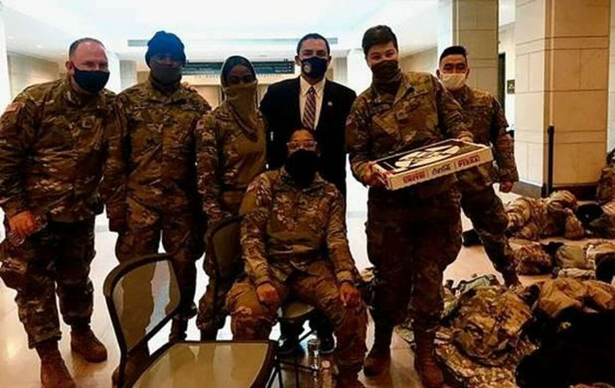 Laredo's Rep. Henry Cuellar poses with members of the National Guard after delivering them a pizza at the Capitol building in Washington, D.C.