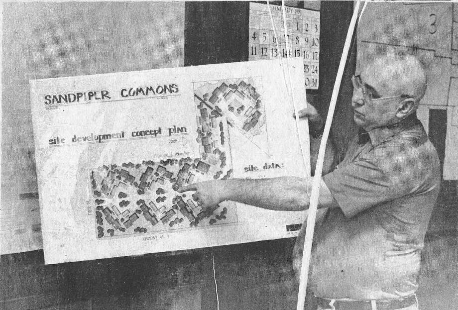 From the Jan. 16, 1981 front page of the Manistee News Advocate, City Assessor Jerry Superczynski points to a site development concept plan for Sandpiper Commons, a proposed 90-unit townhouse and condominium complex to be located at the corner of First and Cherry Street. (Manistee County Historical Museum photo)