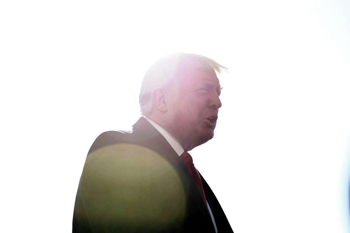 President Donald Trump speaks to reporters outside the White House on Tuesday, Jan. 12, 2021, before leaving Washington for a trip to the U.S.-Mexico border.