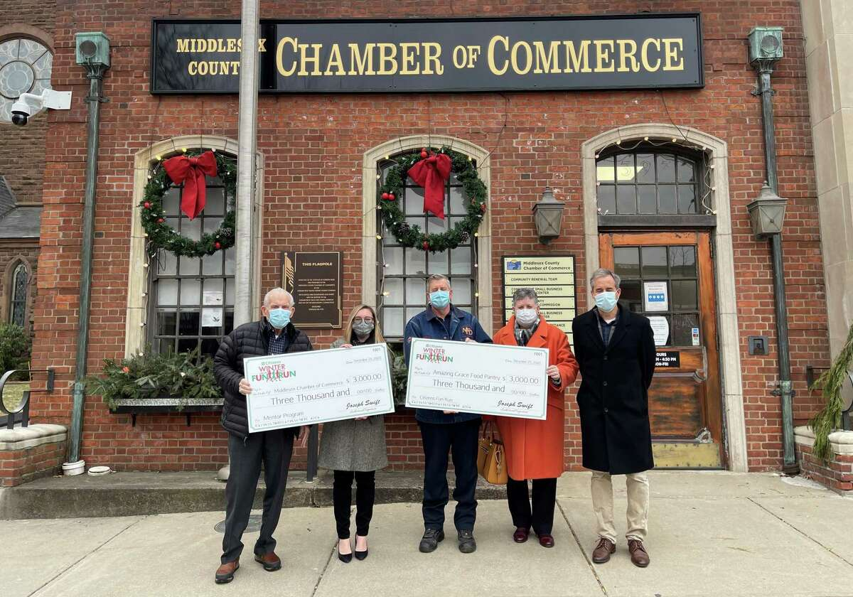 The Citizens Bank 5K Winter Fun Run was held virtually in December. The Hal Kaplan Middletown Mentor Program and Amazing Grace Food Pantry were recipients of the race proceeds. Shown at the Jan. 11 check presentation is Middlesex County Chamber of Commerce President Larry McHugh, Melissa Alecia, manager, Citizens Bank, South Main Street, Middletown; Jay Woron, race committee president; Maryellen Shuckerow, executive director of St. Vincent De Paul Middletown and John Bysiewicz, race director.