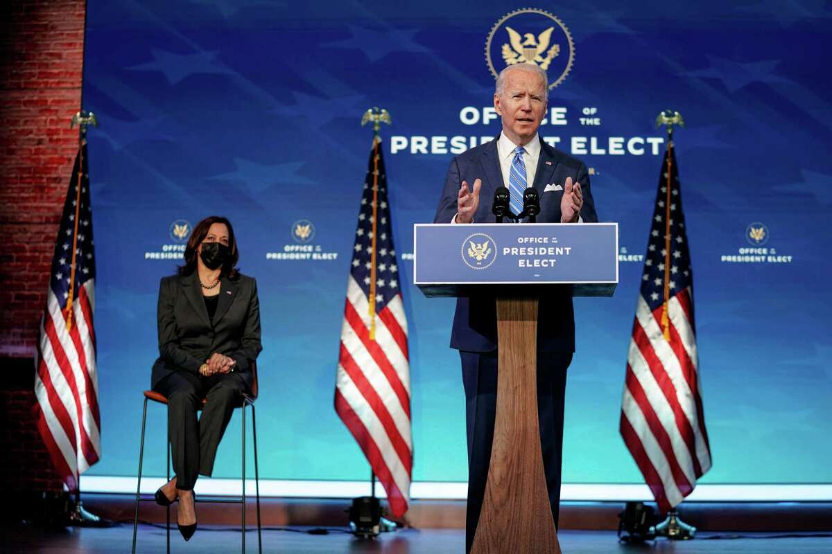 President-elect Joe Biden, joined by Vice President-elect Kamala Harris, speaks at the Queen Theater in Wilmington, Del., on Thursday, Jan. 14, 2021. Biden proposed a $1.9 trillion rescue package to combat the economic downturn and the COVID-19 crisis. (Amr Alfiky/The New York Times)