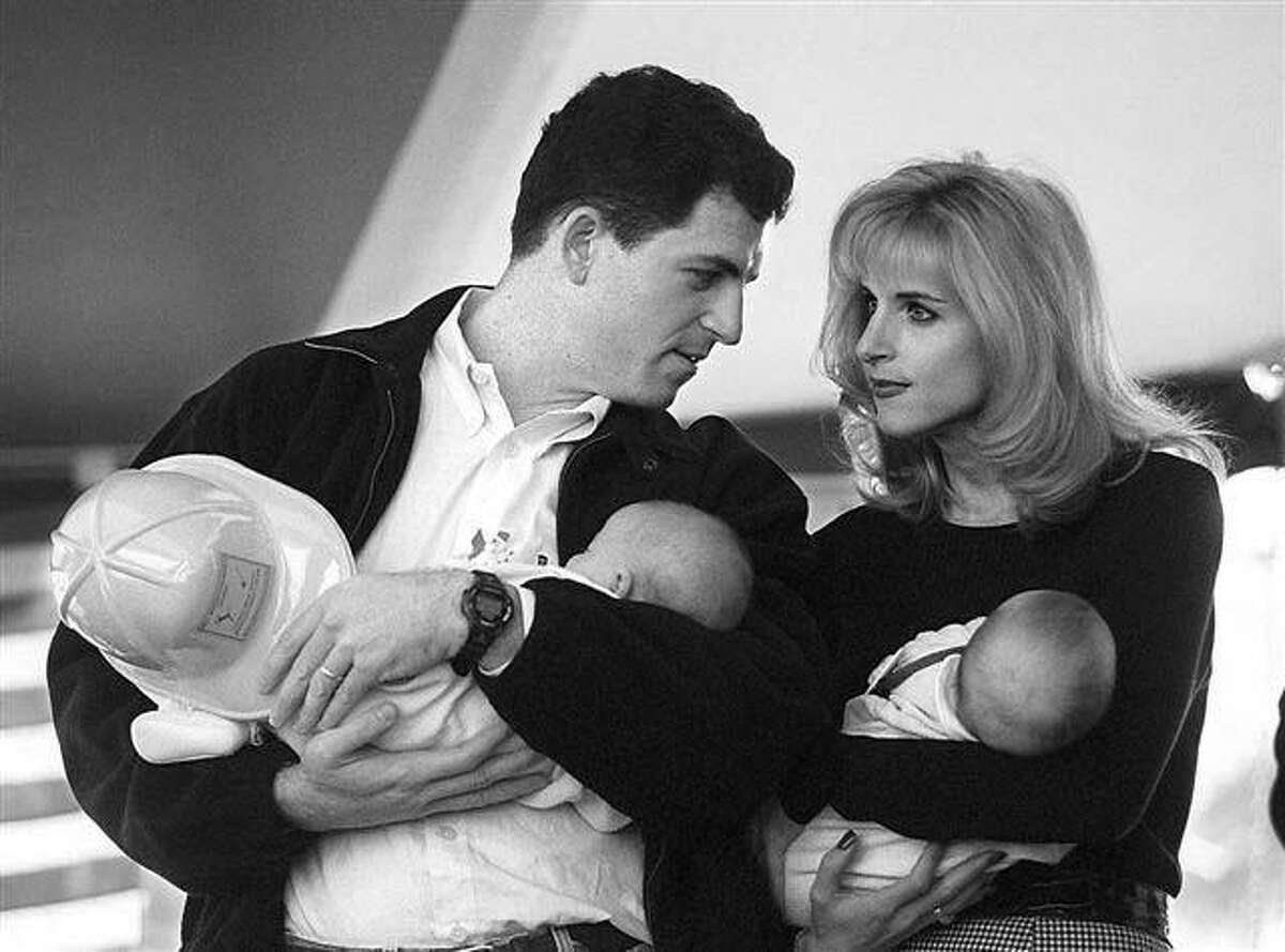 Michael Dell, founder of Dell Computers, and his wife Susan cradle their newborns in this 1996 photo. Lynne Dobson/Austin American-Statesman.