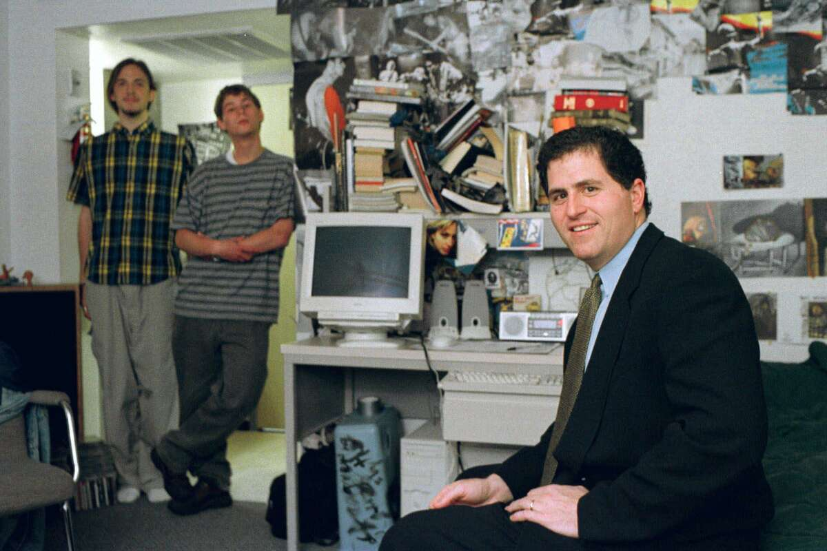 Computer whiz Michael Dell, foreground, sits in a dorm room at the University of Texas Friday, Feb. 26, 1999, in Austin, Texas. It is the room where 15-years-ago he launched his $18.2 billion global enterprise as a college freshman.(AP Photo/Harry Cabluck)