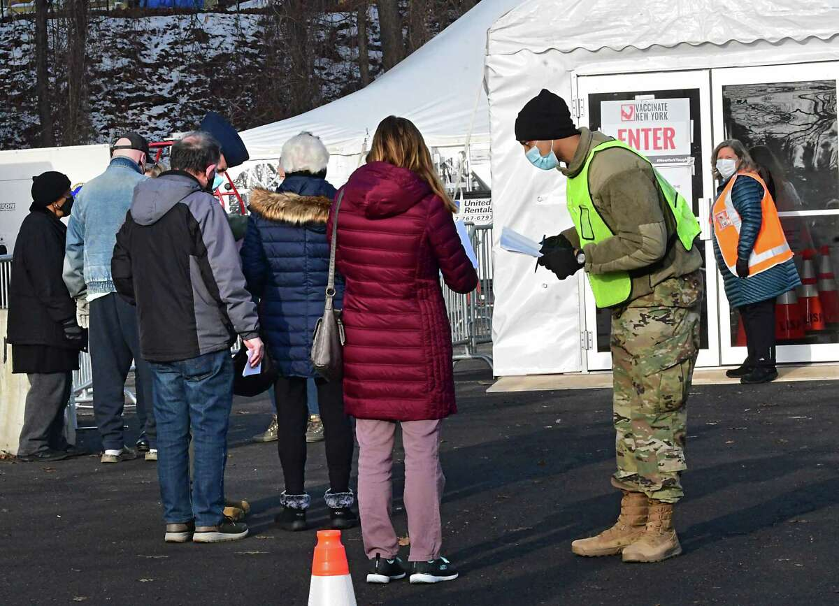 People check in with personnel to receive the COVID-19 vaccine at University at Albany on Friday, Jan. 15, 2021 in Albany, N.Y. The mass-vaccine site opened today at this location. (Lori Van Buren/Times Union)