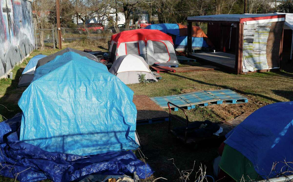 Tents are seen behind a business along Frazier Street. After several years of discussion and concern from residents, the Conroe City Council approved several changes to its camping ordinance to help stop those living permanently in tents and other makeshift housing around the city.