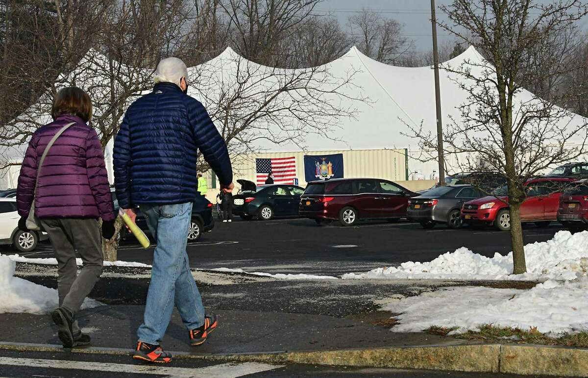 In the Capital Region, sites to inoculate residents against COVID-19 include the parking lot at University at Albany, which opened Jan. 15. Doctors are having a difficult time securing doses for their patients. Demand for the vaccine is far outweighing the supply, state Department of Health officials say. (Lori Van Buren/Times Union)