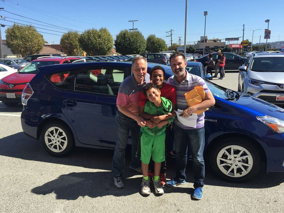 """The Fisher-Paulson family pose together after purchasing a 2017 Prius, known to them as """"the Kipcap,"""" on Aug. 28, 2016."""