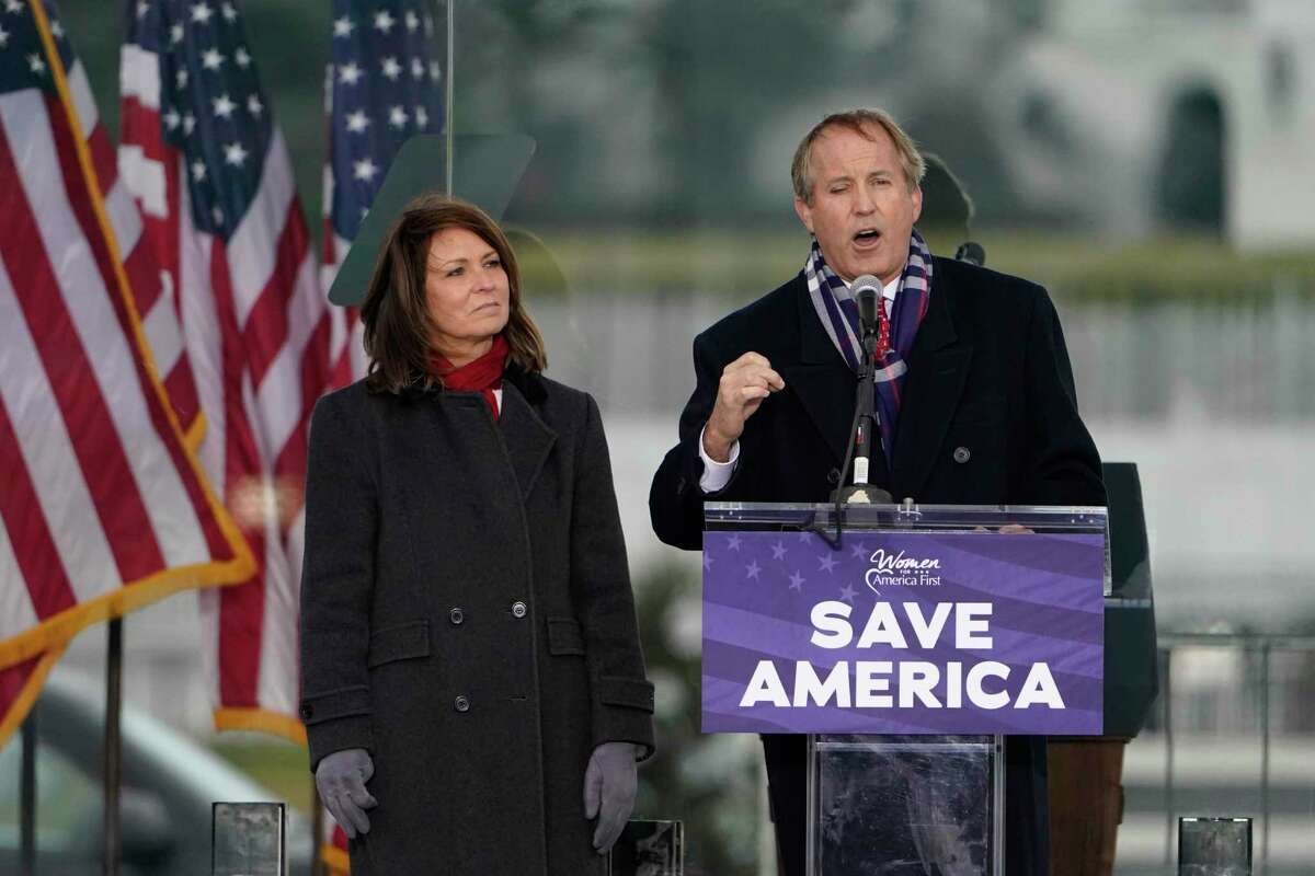 """Indicted Attorney General Ken Paxton speaks at the 'Save America Rally."""" His office hasn't released the full cost of his lawsuit to subvert the presidential election, which would have ruined America."""