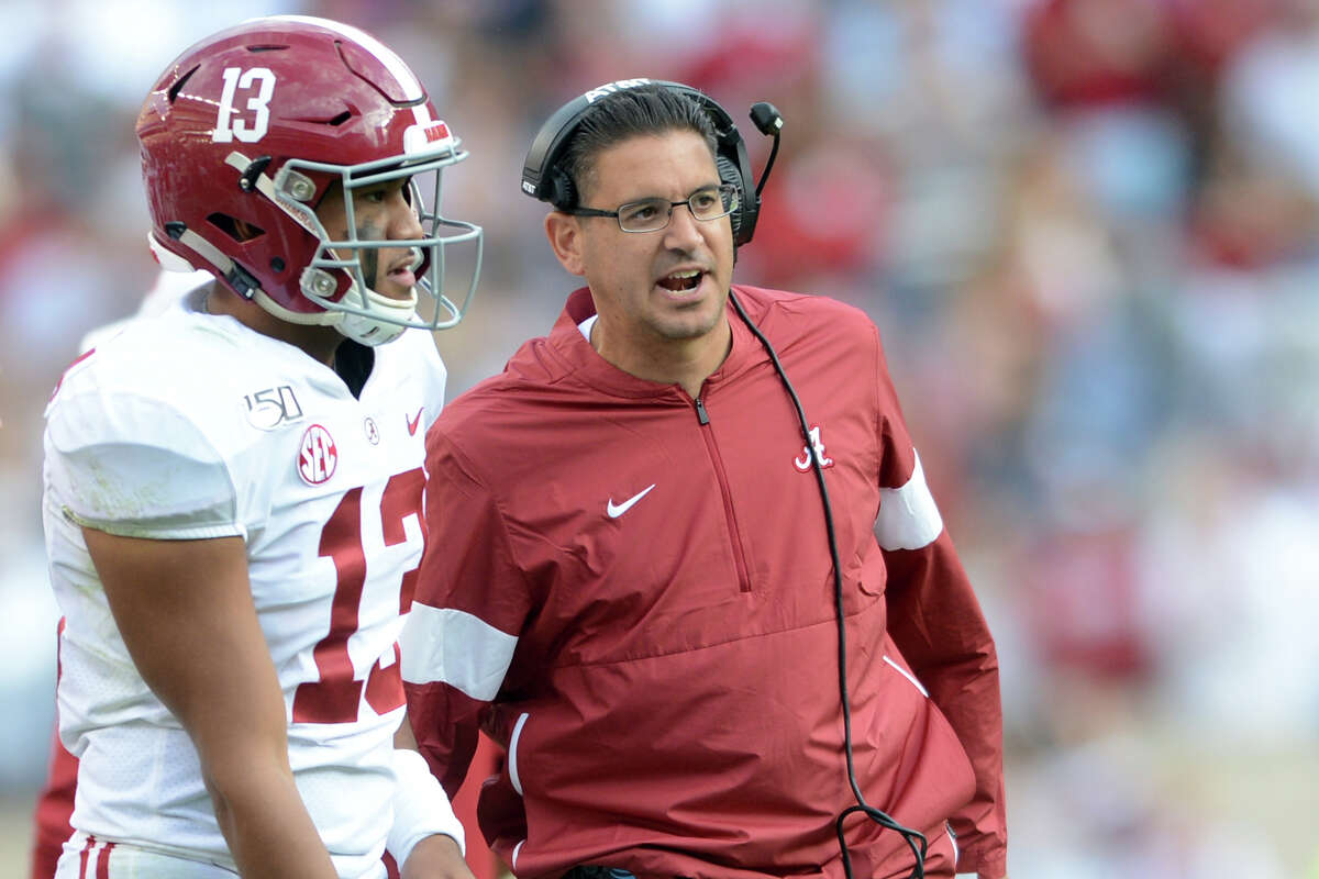 Jeff Banks, pictured with Alabama quarterback Tua Tagovailoa during the 2019 season, is considered one of the country's top special-teams coaches.