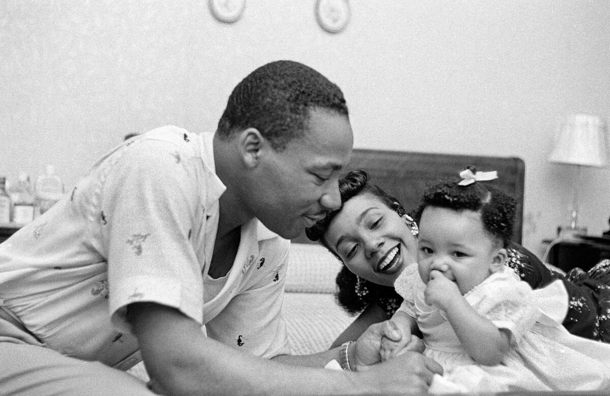 Civil rights leader Reverend Martin Luther King, Jr. relaxes at home with his wife Coretta and first child Yolanda in May 1956 in Montgomery, Alabama.