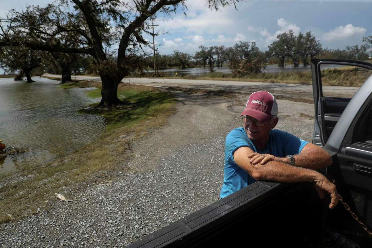 """David Ball takes a break while checking the damage to his property Saturday, Aug. 29, 2020, in Cameron Parish near Grand Chenier, La. """"It's essentially that you start everything all over again,"""" he said. """"I'm 70 years old, I don't know if I want to do it again."""" Hurricane Laura made landfall nearby early Thursday morning. Stronger hurricanes are expected to become more common as the planet warms."""