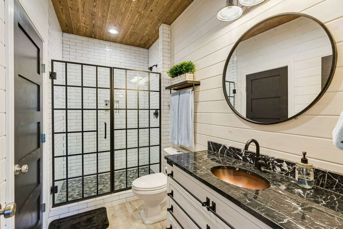 Homeowners today are more willing to mix and match colors and finishes when designing a bathroom. Give a room high visual energy by mixing rustic wood cabinets with a modern, polished quartz counter top, copper sink and a pop of color in the tile