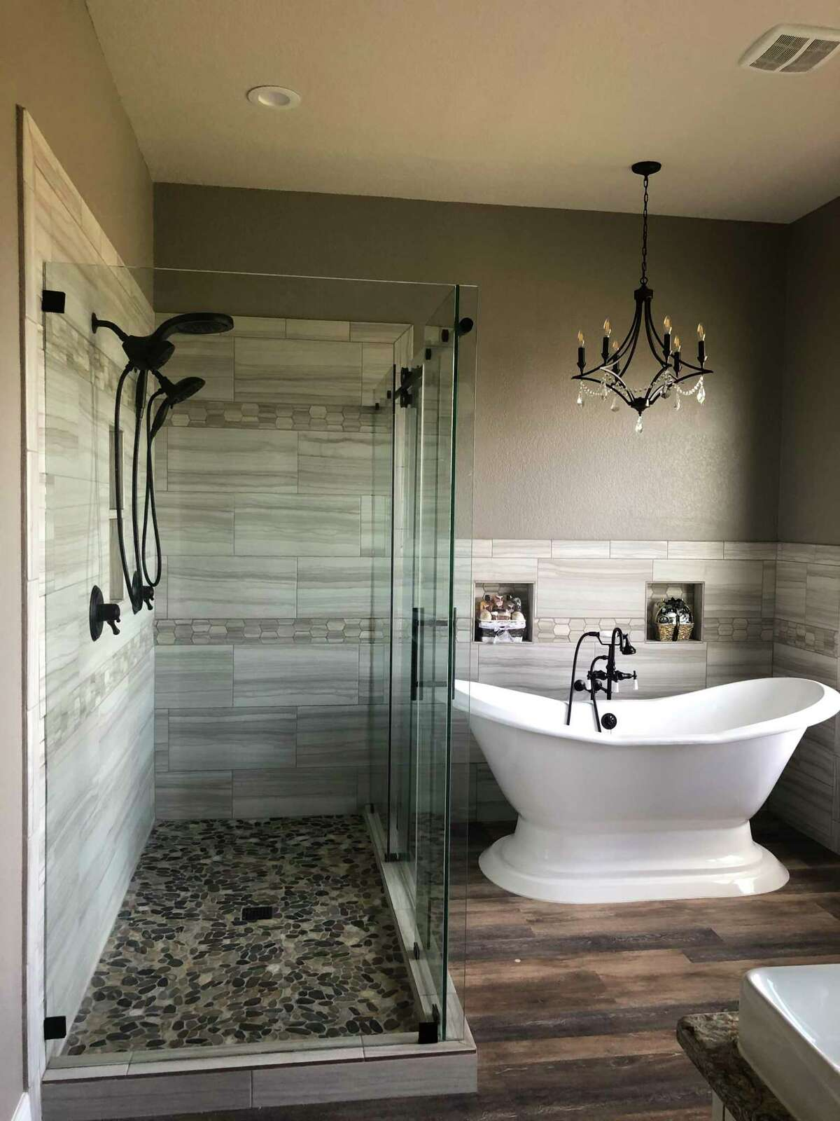 Free-standing soaking bathtubs have a deeper tub than traditional bath/shower combos for a more luxurious soaking experience.