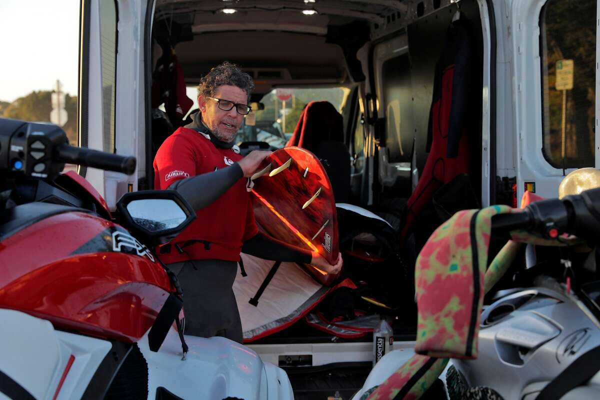 Peter Mel, 50-year-old Santa Cruz surfer, stows his gear after a day surfing Mavericks outside Half Moon Bay, Calif., on Wednesday, January 13, 2021. Mel accomplished some historic rides at Mavericks over the weekend.
