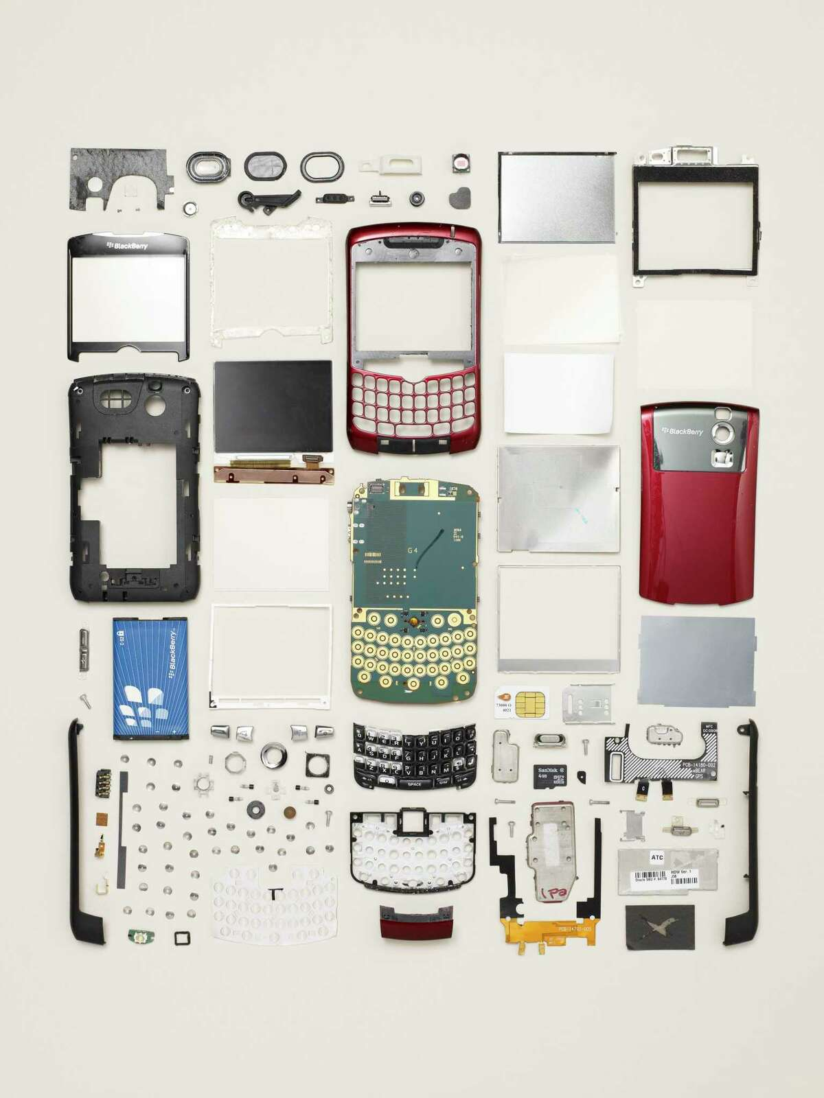 Todd McLellan photographs disassembled objects like a cell phone for his show