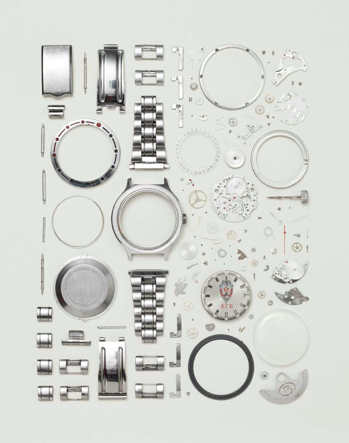 Todd McLellan photographs disassembled objects like this watch for his show
