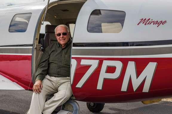 Angel Flight volunteer pilot Stephen Wright with his beloved Piper Malibu Mirage.
