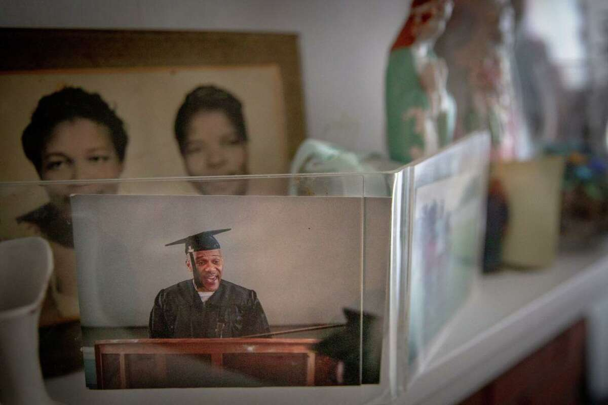 A photo of Clyde Meikle from a graduation ceremony for his associate's degree on display in his mother's home.