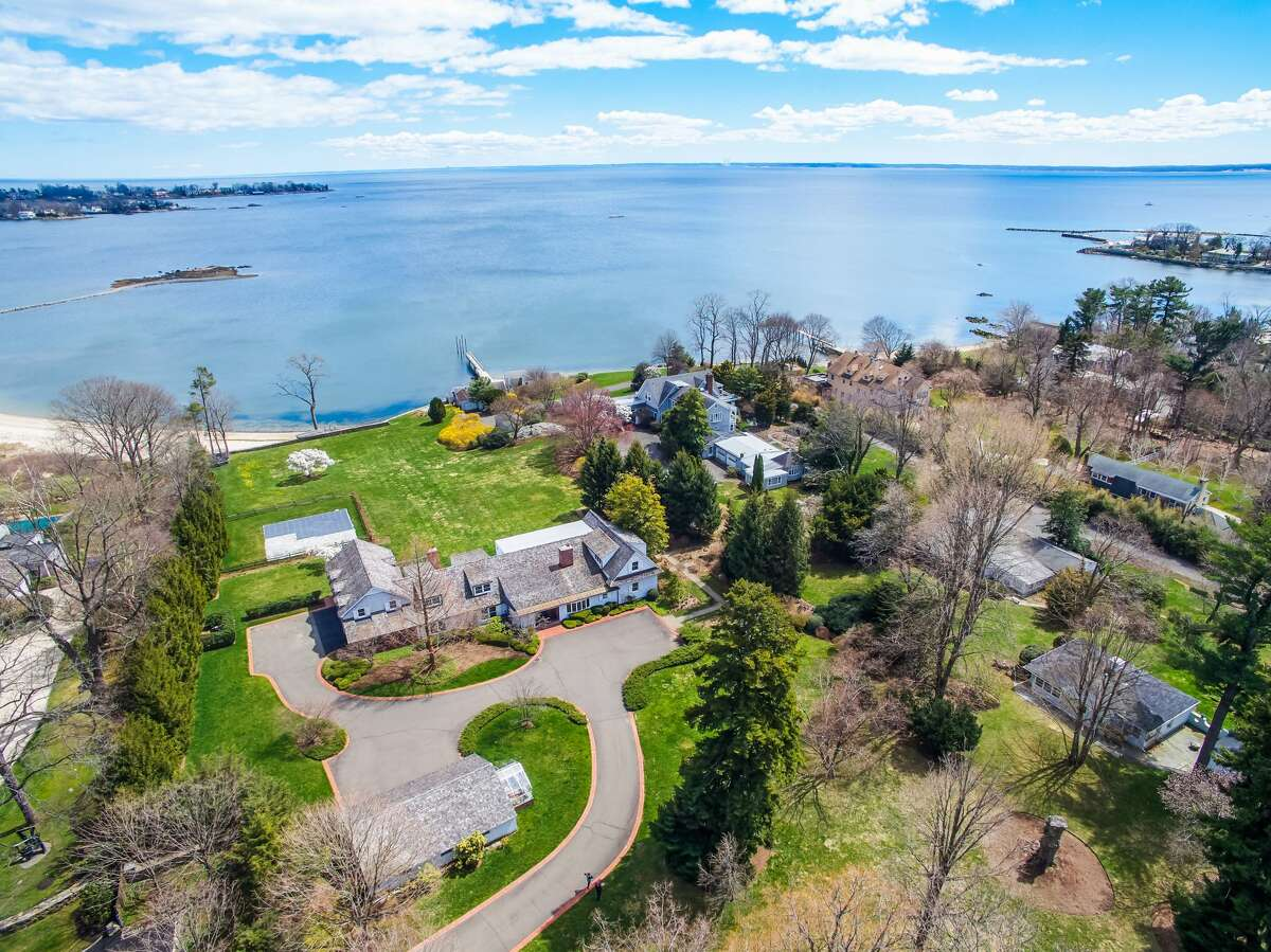 Waterfront property at 18 Wallacks Drive, Stamford. A previous owner was a landscape architect, according to Listing Agent Jennifer Runnette, so this estate features two greenhouses and manicured formal gardens, including a star magnolia tree, a variety of perennial plantings, rose bushes and hydrangea shrubs that hug one of the five cottages and line the red brick sitting wall along a patio on this property. The two updated and expanded vintage houses - a fieldstone manor house and a carriage house built in 1890 - combined with all the cottages total 55 rooms, 19 bedrooms, 24 bathrooms (20 full and four half baths) and 20,264 square feet of living space. There are also several garages providing enough bays to accommodate 13 vehicles. One of the bays is currently set up as an exercise area with a bathroom.