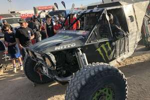 Fans gather around a racer at the 2018 King of the Hammers off-road event in San Bernardino County, Calif.