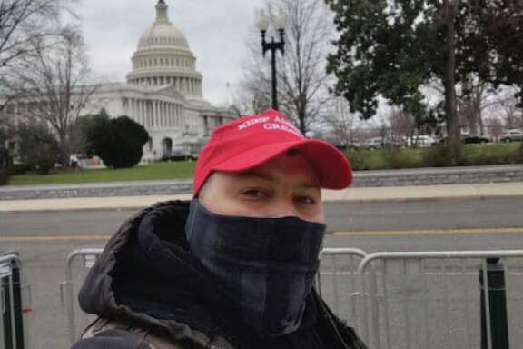 "Authorities have charged Joshua Lollar, 39, in the Wednesday, Jan. 6, 2021 insurrection at the U.S. Capitol. FBI officials say he traveled from Texas and participated in the riot, appearing to be on the ""front lines"" of people confronting Metropolitan police trying to get into the building."