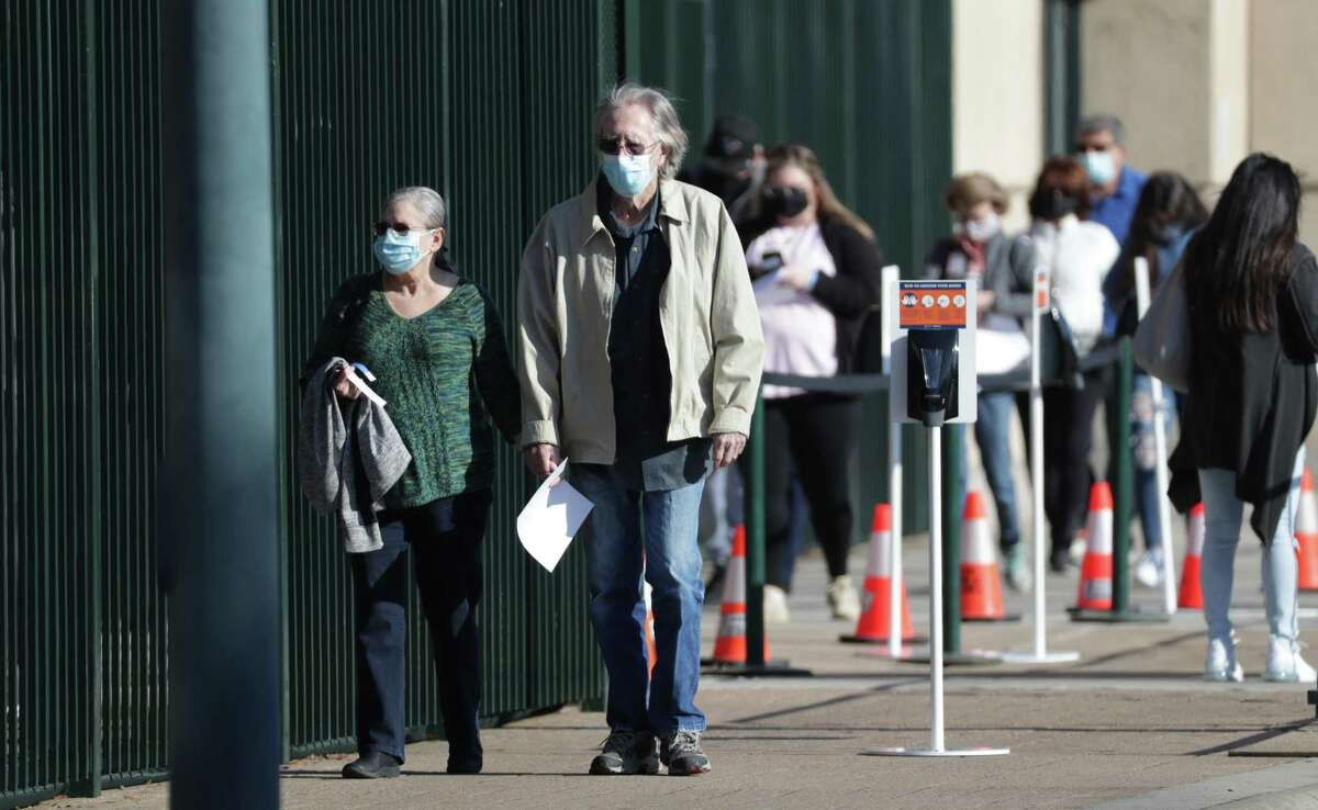 Some area residents waited in line to receive their COVID-19 vaccines at Minute Maid Park, which will serve as a temporary site as the Bayou City Event Center is closed for an unrelated event Saturday, Jan. 9, 2021, in Houston.